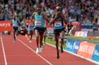 Mo Farah (GB) starts to celebrate after outsprinting Yenew Alamirew (Eith) in the 5000 metres at the IAAF Diamond League, Birmingham.