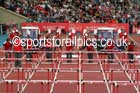 Puttng out the hurdles at the Commonwealth Games, Glasgow. Photo: David T. Hewitson/Sports for All Pics