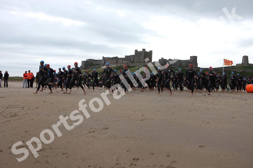 Start of the swimming during the Bamburgh Triathlon with Bamburgh Castle in the background